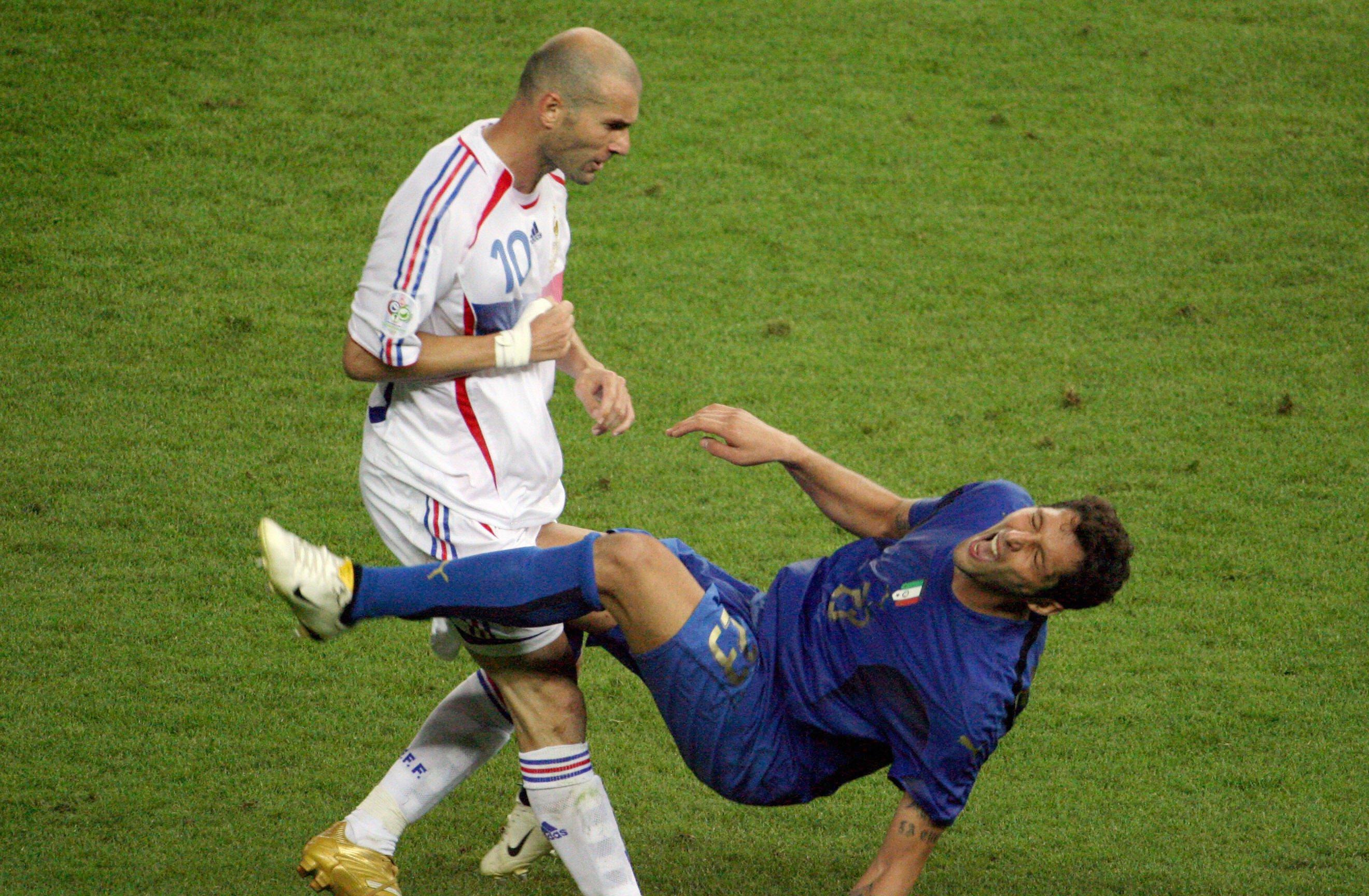 French midfielder Zinedine Zidane (L) gesturing after head-butting Italian defender Marco Materazzi