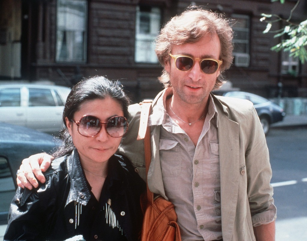 In this Aug. 22, 1980, file photo, John Lennon, right, and his wife, Yoko Ono, arrive at The Hit Factory, a recording studio in New York City. The death of Lennon, shot 35 years ago, still reverberates as a defining moment for a generation and for the music world. (AP Photo/Steve Sands, File)