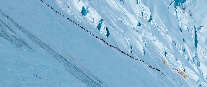 Everest climbers form a long snaking line up the mountain as they strive to reach the summit this spring.. Photo by Ralf Dujmovits