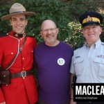 NDP MP Randall Garrison (centre) with RCMP officers.