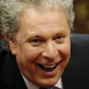 Quebec's Premier Jean Charest smiles during swearing-in ceremony of his new cabinet in Quebec City