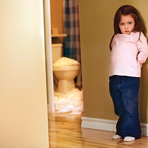 Girl standing outside bathroom