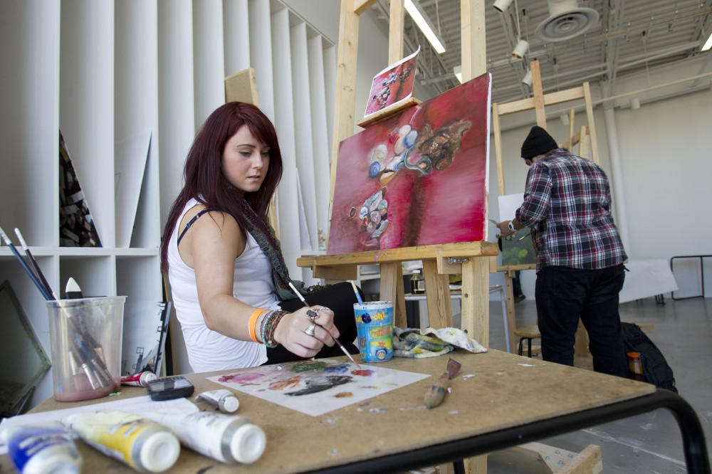 Crystal Desrochers Works On Her Painting In The ARTlab