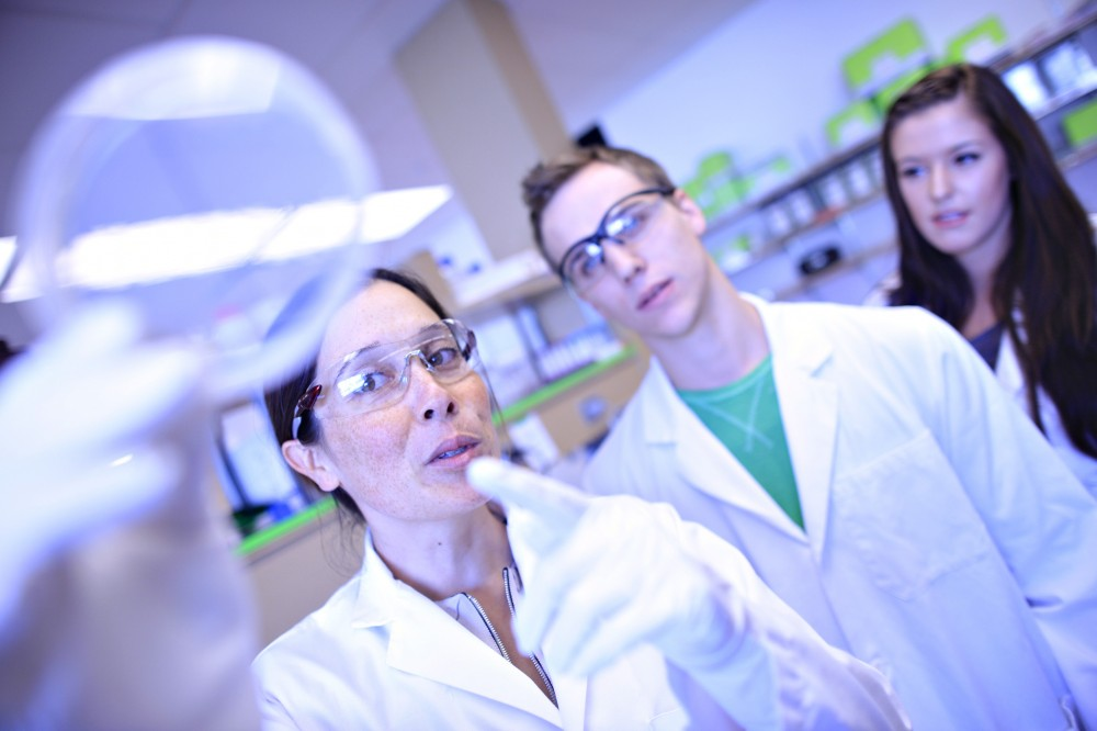 Prof. Zabrina Brumme works with Ryan Danroth and Chantel Watts in a lab