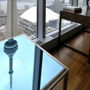 The CN Tower is reflected on an end table in the dining room of the Ritz Carlton residents model suite in Toronto May 1, 2012.