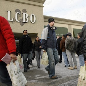 Customers line up at liquor store