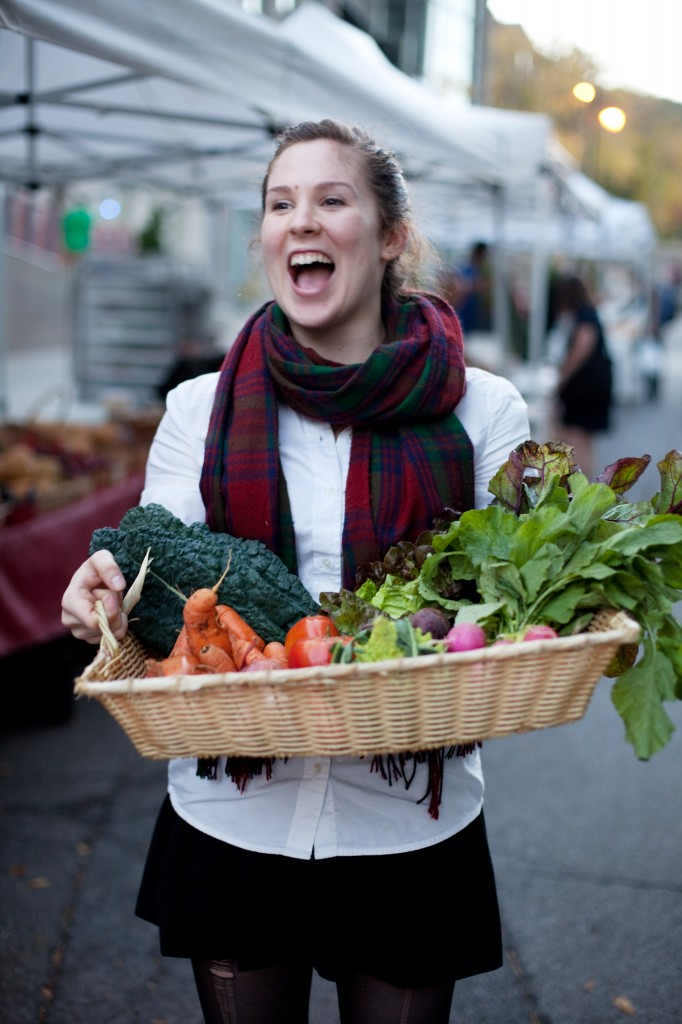 Student Kathleen Bradley with a basket of vegetables grown at McGill's Macdonald Campus. (Roger Lemoyne for Maclean's)