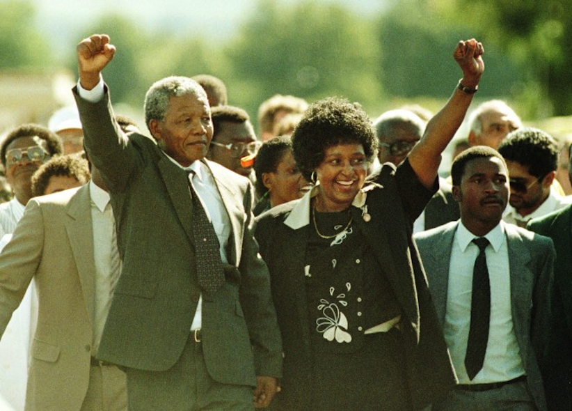Nelson Mandela, seen with his wife and campaigner Winnie Mandela following his release from the Victor Verster Prison in Cape Town after 27 years of imprisonment, February 11, 1990. (Camera Press/Gallo Images/Foto24/Graeme Williams/South Photographs)
