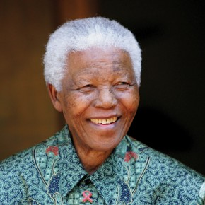 Former South African President Nelson Mandela smiles for photographers in Johannesburg