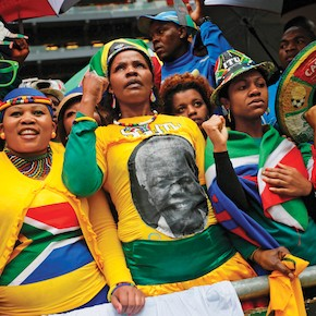 People sing and dance at official memorial service for Mandela in Johannesburg