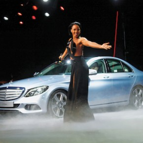 Musician Kelly Rowland performs next to the new Mercedes-Benz 2015 C-Class during a private preview for media at the Westin Book Cadillac Hotel in Detroit, Michigan