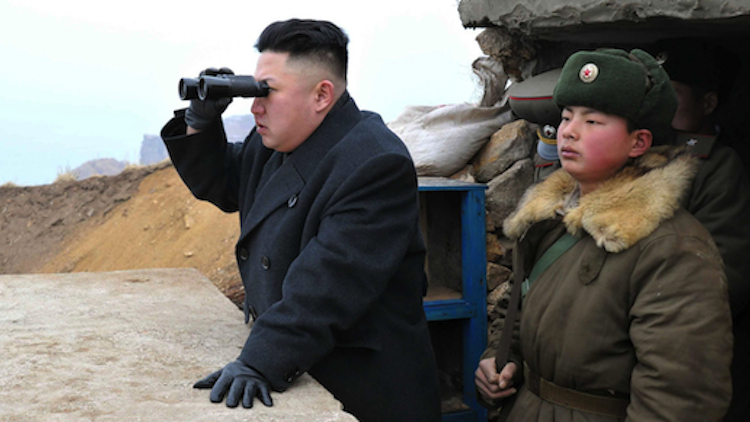 Kim Jong Un, center, uses binoculars to look at the South's territory from an observation post at the military unit on Jangjae islet in a photo released by the Korean Central News Agency (KCNA) on March 8, 2013. (AP)