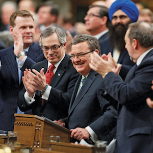 Canada's Finance Minister Jim Flaherty is applauded before delivering the federal budget in the House of Commons on Parliament Hill in Ottawa