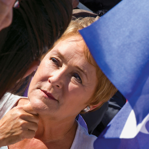 Parti Quebecois leader Pauline Marois speaks to supporters at an outdoor market during a campaign stop in Chateauguay Quebec