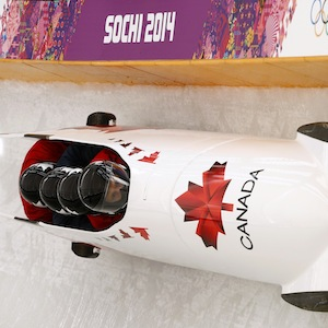 Canada's four-man bobsleigh pilot Rush speeds down the track during an unofficial progressive training at the Sanki sliding center at the Sanki sliding center in Rosa Khutor