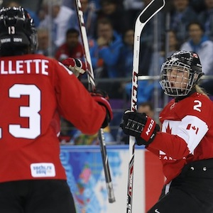 Canada's Agosta-Marciano celebrates her goal against Finland with teammate Ouellette during the third period of their women's ice hockey game at the Sochi 2014 Sochi Winter Olympics
