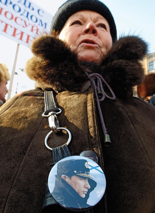 A woman wearing a badge with a portrait of Russian Prime Minister Vladimir Putin attends a rally in support of his presidential candidacy in St.Petersburg in 2012. Alexander Demianchuk/Reuters