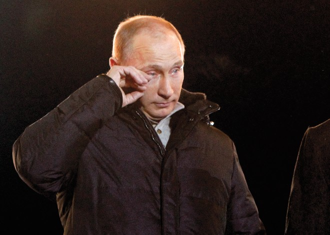 Russia's current PM and presidential candidate Vladimir Putin tearfully addresses supporters during a rally in Manezhnaya Square near the Kremlin in central Moscow. (Mikhail Voskresensky/Reuters)