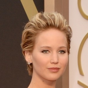 "Only in Hollywood could Jennifer Lawrence, in strapless scarlet Dior, be called ""brave"" for wearing the same hue she wore to the Oscars in 2011."
