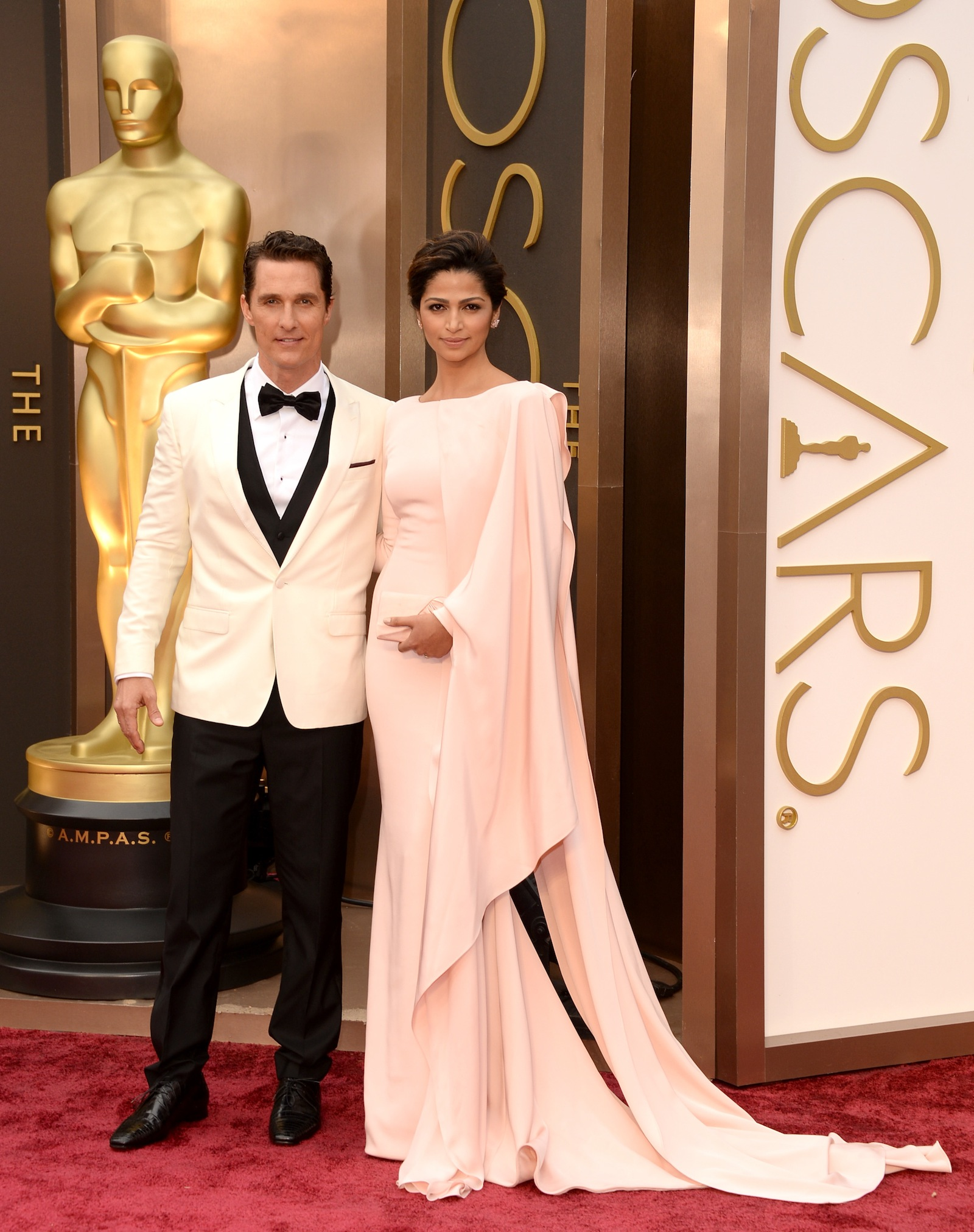 The king and queen of the pastel prom: Matthew McConaughey and wife Camila Alves.