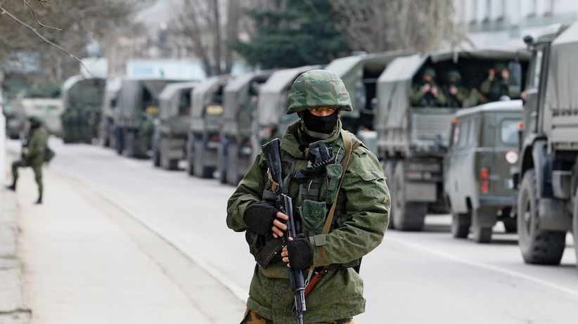 Armed servicemen wait in Russian army vehicles outside a Ukranian border guard post in the Crimean town of Balaclava March 1, 2014. (Baz Ratner, Reuters)