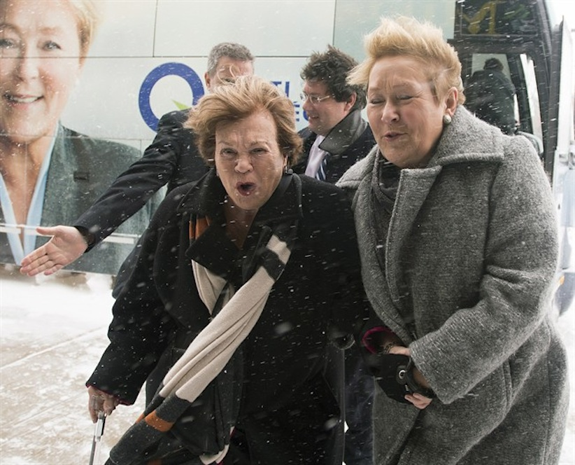 Parti Quebecois Leader Pauline Marois, right, arrives with women's rights activist Janette Bertrand during a Quebec provincial election campaign stop in Laval, Que., Sunday March 30, 2014. (Graham Hughes/The Canadian Press)