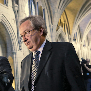 Canada's Chief Electoral Officer Mayrand leaves after testifying before the Commons procedure and House affairs committee on Parliament Hill in Ottawa