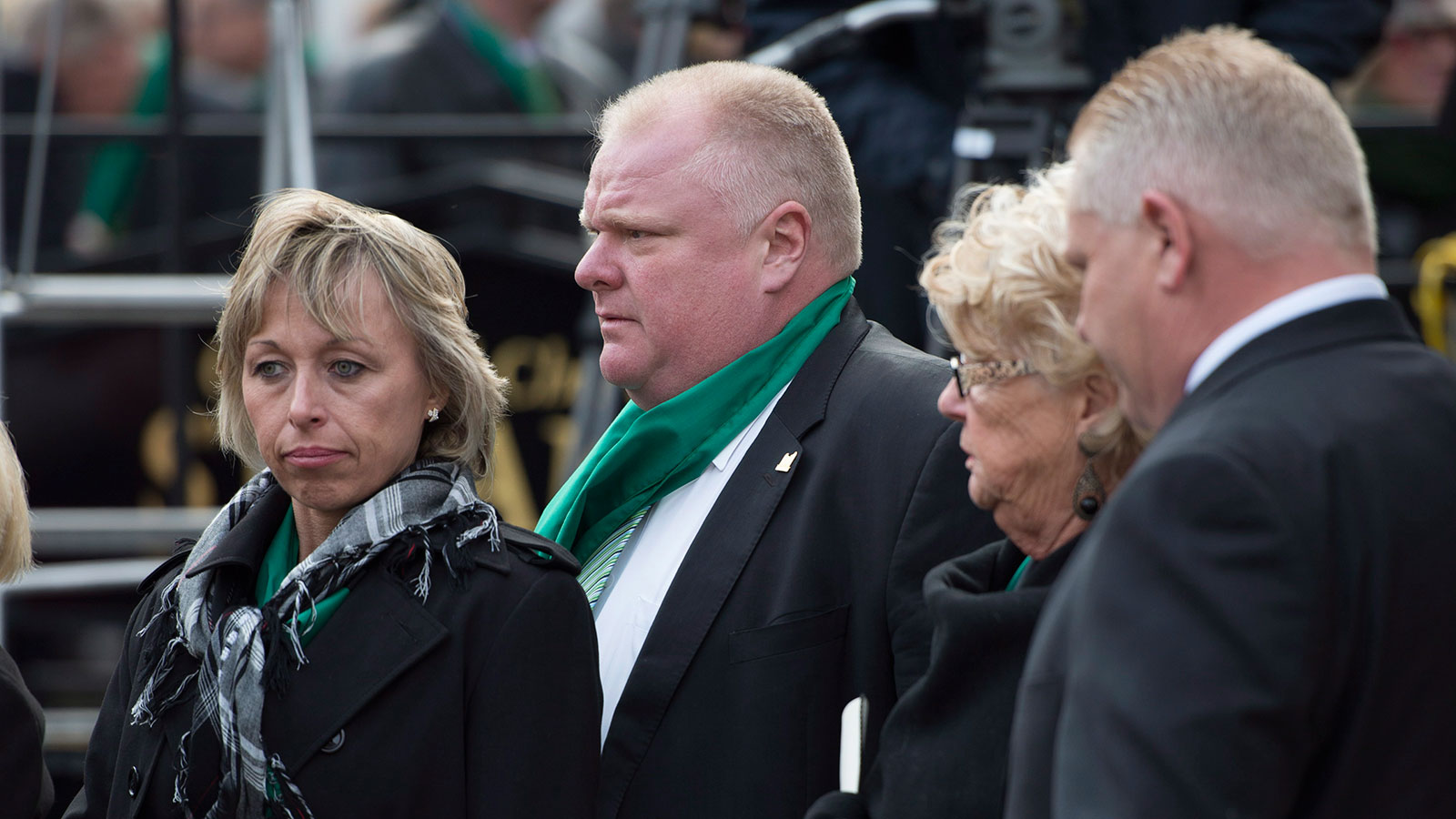 Mayor Rob Ford, second from left, with his wife Renata, left, mother Diane, and brother Doug, following the state funeral for Jim Flaherty in Toronto on Wednesday, April 16, 2014. (Darren Calabrese/CP)