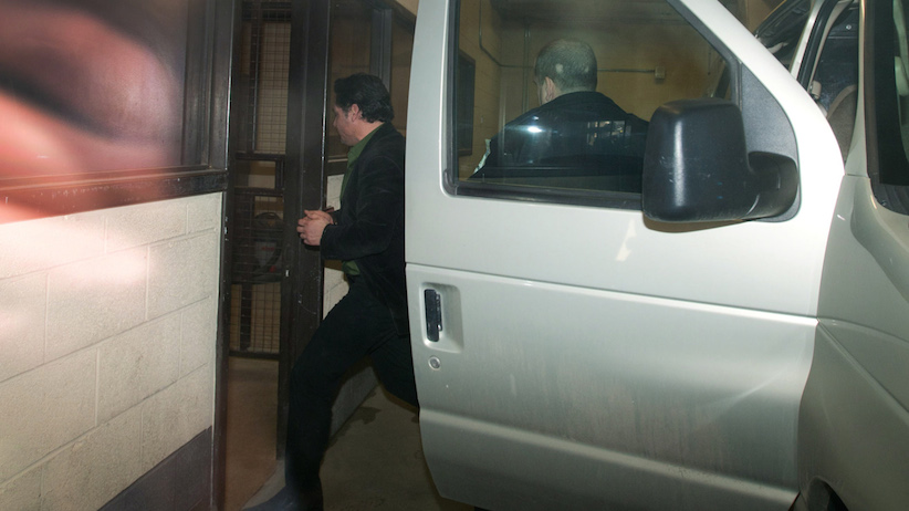Patrick Brazeau is escorted into the Gatineau Court House in Gatineau, Quebec on Thursday, April 10, 2014. (Sean Kilpatrick/CP)
