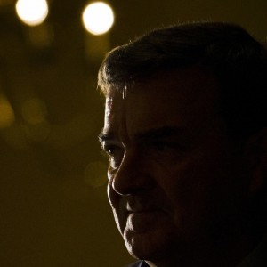 Jim Flaherty, finance minister of Canada, looks on before speaking to economic community in Toronto
