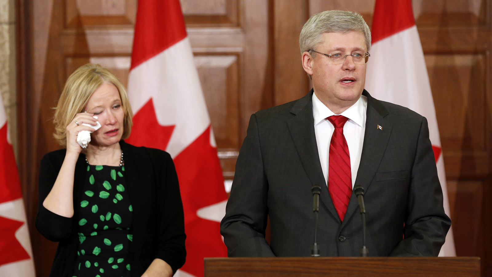 PM Stephen Harper and his wife Laureen take part in a news conference following the news of former Finance Minister Flaherty's death on Parliament Hill in Ottawa