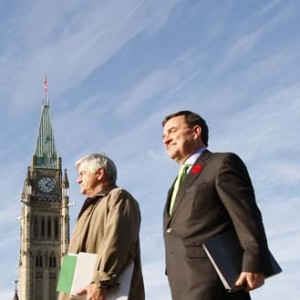 Canada's Finance Minister Jim Flaherty (R) walks to a news conference on the government's fiscal update with Transport Minister Lawrence Cannon, on Parliament Hill in Ottawa October 30, 2007.        REUTERS/Chris Wattie   (CANADA) - RTR1VHUO