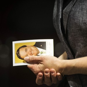 A woman holds a picture of former Canadian Finance Minister Jim Flaherty at the visitation service at the Abilities Centre in Whitby