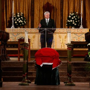 Canada's Prime Minister Stephen Harper speaks at the state funeral for former finance minister Jim Flaherty in Toronto,  April 16, 2014. REUTERS/Mark Blinch (CANADA  - Tags: POLITICS OBITUARY)   - RTR3LKLO