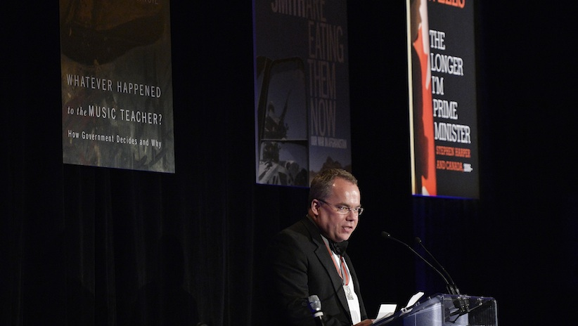 (Photo by Matthew Usherwood for the Writers' Trust.) Paul Wells accepts the Shaughnessy Cohen Prize for Political Writing.