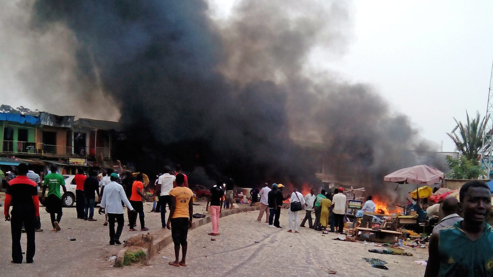 Smoke rises after a bomb blast at a bus terminal in Jos, Nigeria, Tuesday, May 20, 2014. Two explosions ripped through a bustling bus terminal and market frequented by thousands of people in Nigeria's central city of Jos on Tuesday afternoon, and police said there are an unknown number of casualties. The blasts could be heard miles away and clouds of black smoke rose above the city as firefighters and rescue workers struggled to reach the area as thousands of people fled. (Stefanos Foundation, AP Photo)