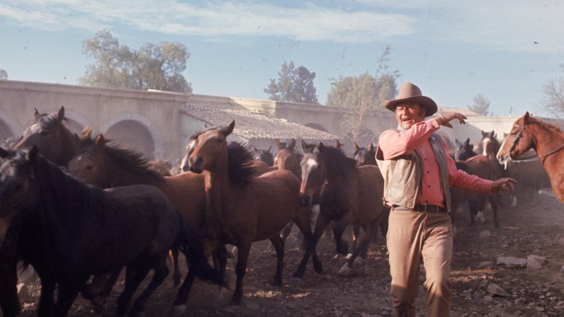 "John Wayne filming scene from western ""The Undefeated"""