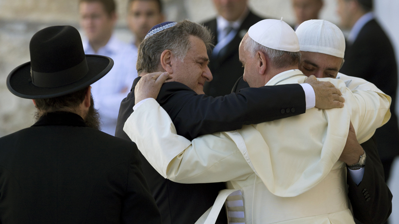 Pope Francis embraces fellow Argentines Rabbi Abraham Skorka and Muslim leader Omar Abboud at the Western Wall in Jerusalem. Jim Hollander/EPA.