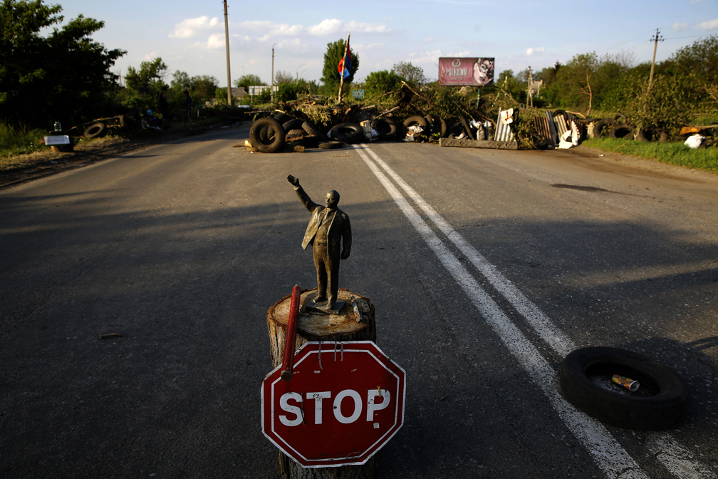 A statuette of Lenin is placed in front of a pro-Russian barricade on the outskirts of the eastern Ukrainian town of Slaviansk on May 10, 2014. (Yannis Behrakis/Reuters)