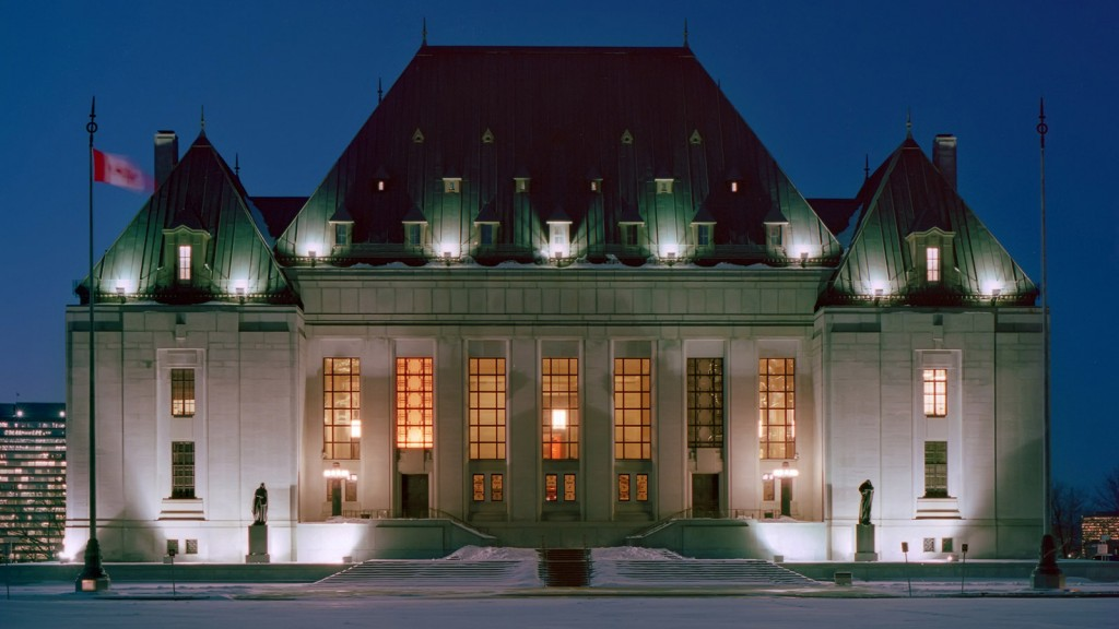 Night photo of front facade of the Supreme Court