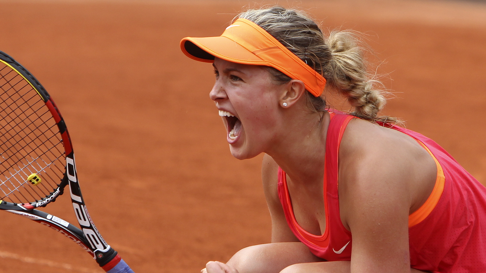 Eugenie Bouchard celebrates after defeating Spain's Carla Suarez Navarro during their quarterfinal match at the French Open on June 3, 2014. (David Vincent/AP)