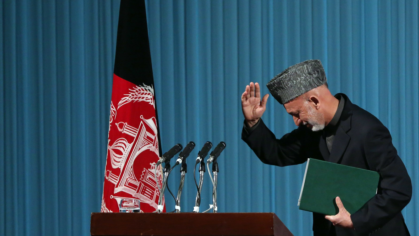 Afghan President Hamid Karzai leaves after a cultural event in Kabul, Afghanistan on Thursday, May 15, 2014. (Massoud Hossaini/AP)