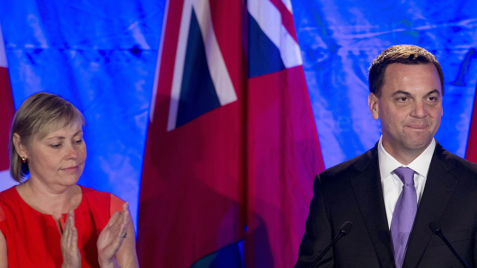 Ontario Progressive Conservative leader Tim Hudak, right, announces next to his wife Deb Hutton that he will be stepping down as party leader after being defeated his election night campaign head quarters in Grimsby, Ont., on Thursday, June 12, 2014. THE CANADIAN PRESS/Nathan Denette