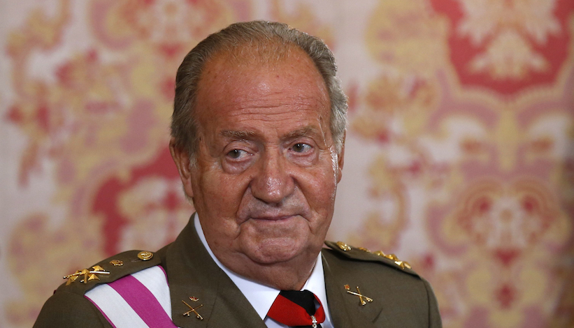 Spanish King Juan Carlos attends a reception marking Spain's Armed Forces Day at the Royal palace in Madrid, Spain, Sunday, June 8, 2014. King Juan Carlos plans to abdicate and pave the way for his son, Crown Prince Felipe, to become the country's next king. The 76-year-old Juan Carlos oversaw his country's transition from dictatorship to democracy but has had repeated health problems in recent years. His popularity also dipped following royal scandals, including an elephant-shooting trip he took in the middle of Spain's financial crisis that tarnished the monarch's image. The king came to power in 1975, two days after the death of longtime dictator Francisco Franco.  (AP Photo/Andrea Comas, Pool)