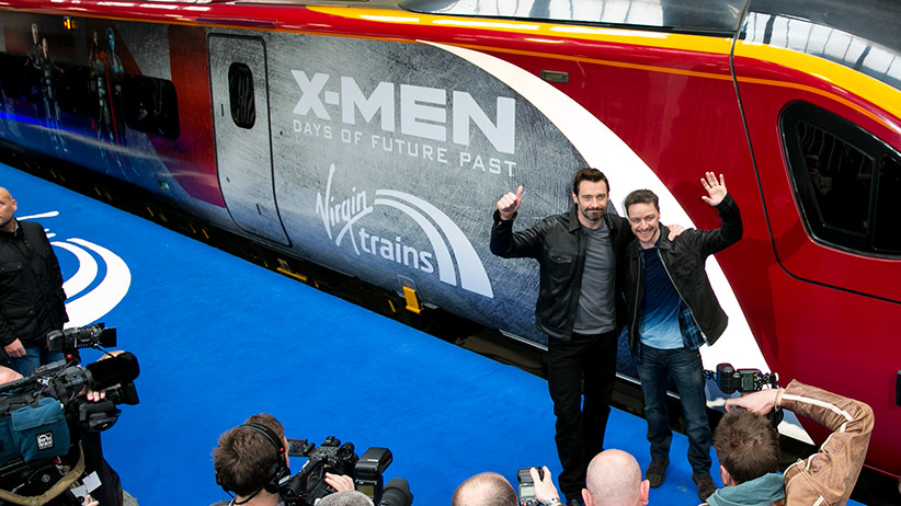 "Hugh Jackman and James McAvoy attend a photocall to unveil the Virgin Trains wrapped ""X-Men: Days of Future Past"" train at Euston Station on March 31, 2014 in London, England. John Phillips/UK Press/Getty Images"