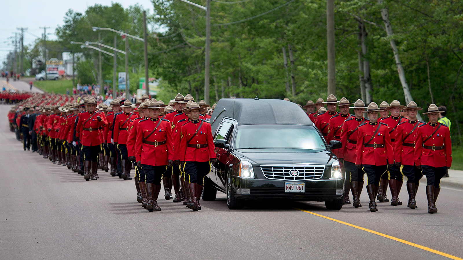 The funeral procession for the three RCMP officers who were killed in the line of duty in Moncton, N.B. (Andrew Vaughan/CP)