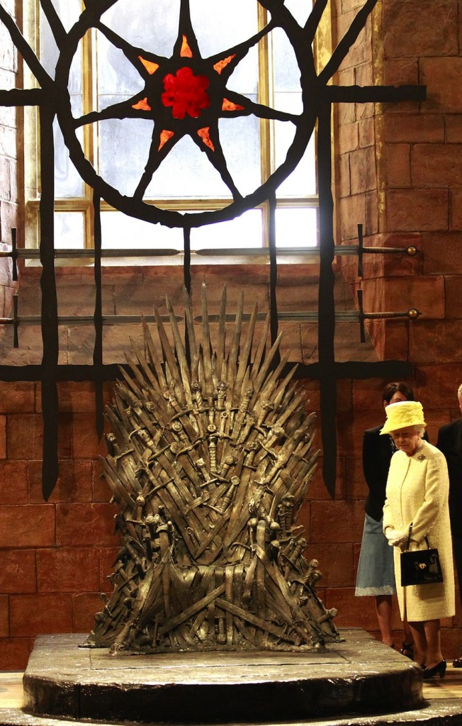 Queen Elizabeth II visits the throne room at the set of the Game of Thrones TV series in Belfast's Titanic Quarter, Northern Ireland. (AP Photo Peter Morrison)