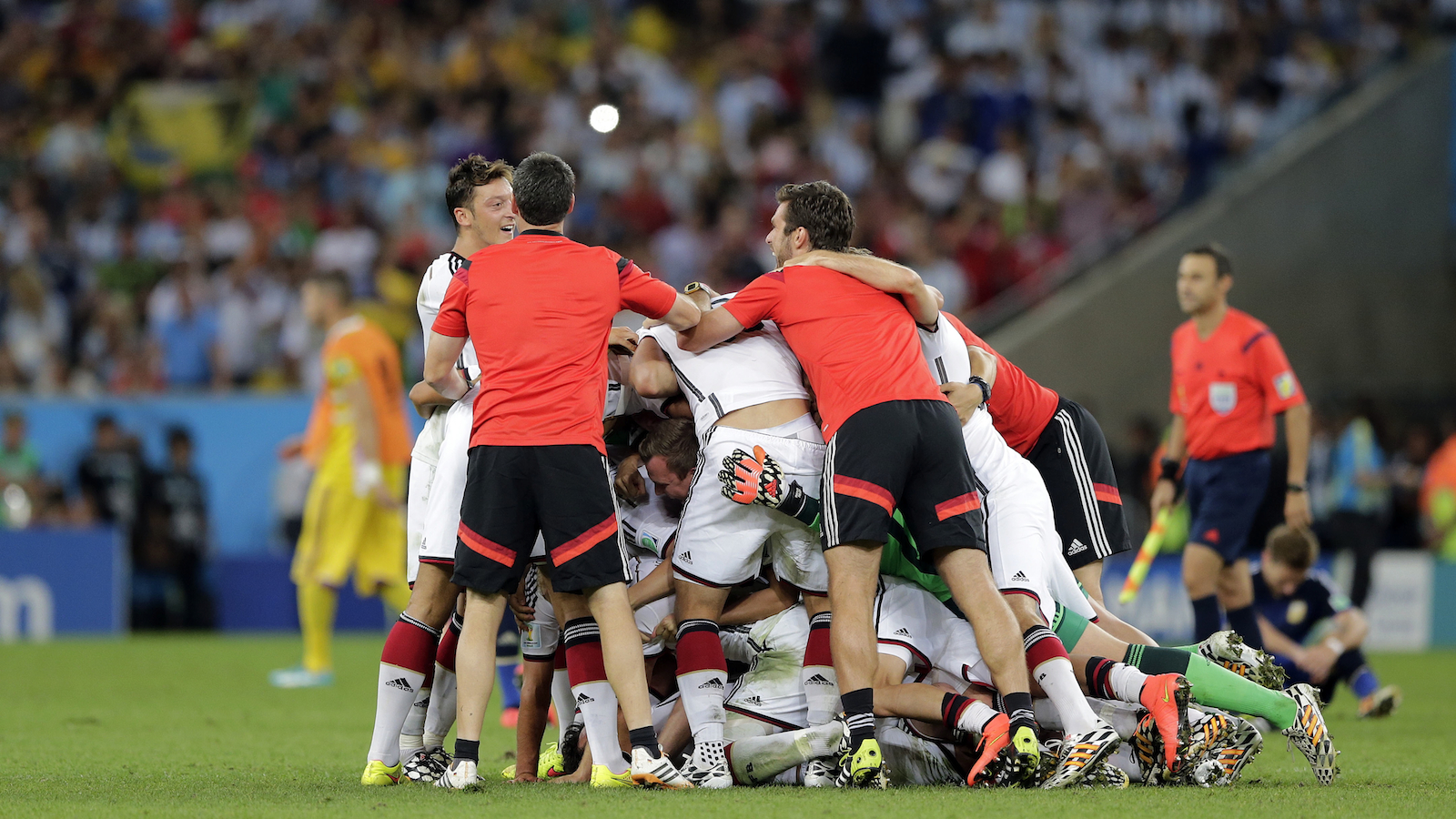 German players celebrate after the World Cup final soccer match between Germany and Argentina at the Maracana Stadium in Rio de Janeiro, Brazil, Sunday, July 13, 2014. Germany won the match 1-0. (Matthias Schrader/AP)