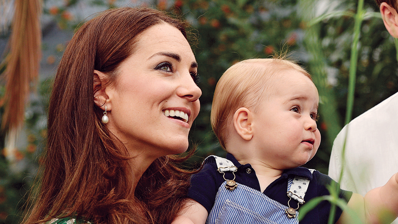 Prince George visits London's Natural History Museum with parents Catherine and Prince William ahead of his first birthday (John Stillwell/Getty Images)