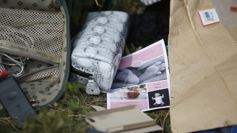 Belongings found at the crash site of Malaysia Airlines Flight MH17 are pictured near the village of Hrabove, Donetsk region